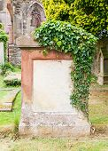 picture of empty tomb  - Very old gravestone with green leaves cemetery in Scotland - JPG