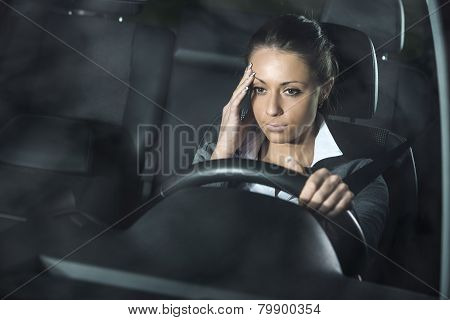 Woman With Headache Driving