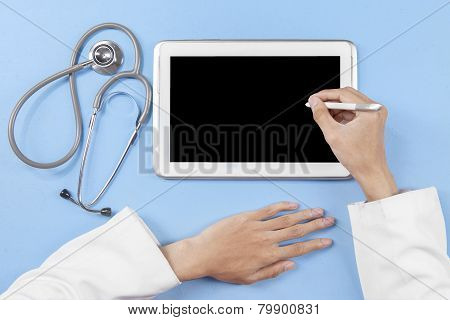 Doctor Hands Using Stylus To Touch Tablet Screen