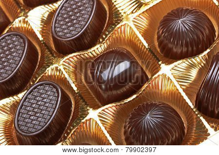 Chocolate pralines in the golden box