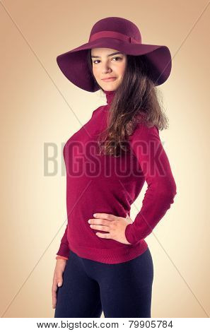 Posing teenager girl with red hat and sweater