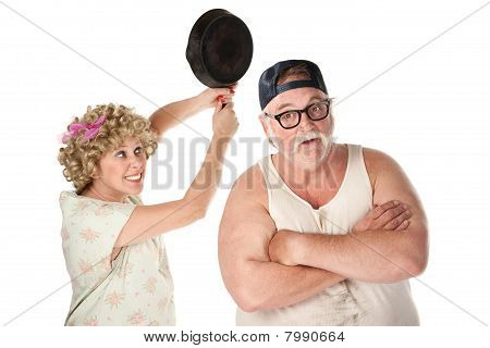 Woman Swinging Frying Pan at Husband