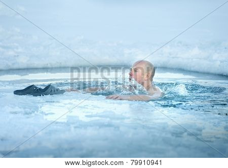 Man bathing in ice cold water
