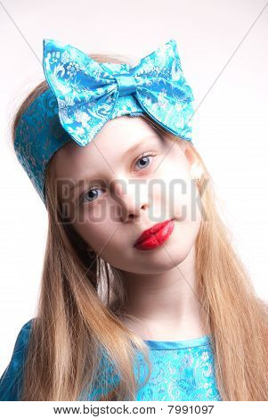 Beautiful Blonde Girl / Child, Studio Portrait Isolated Against White Background