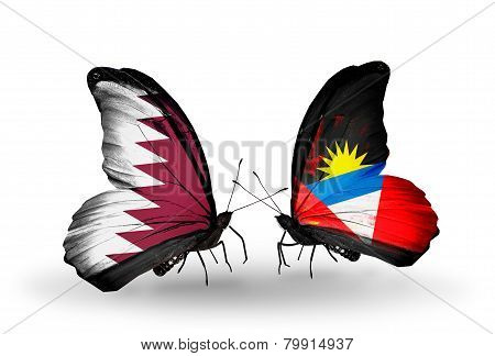 Two Butterflies With Flags On Wings As Symbol Of Relations Qatar And Antigua And Barbuda