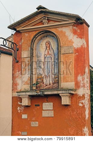 Votive Capitals With The Image Of The Madonna In Italy