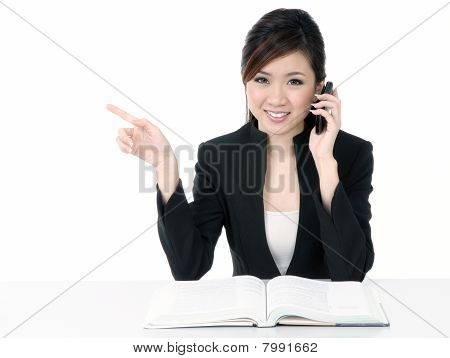 Happy Young Businesswoman Talking On Cellphone