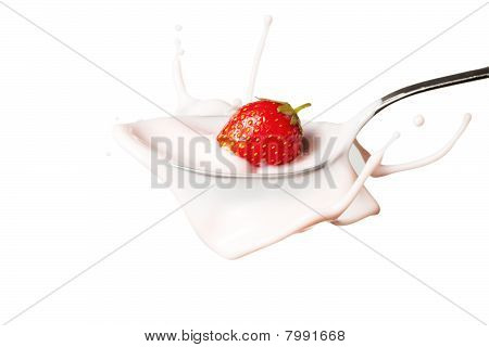 Strawberry Splashing Into The Spoon Full Of Yoghurt