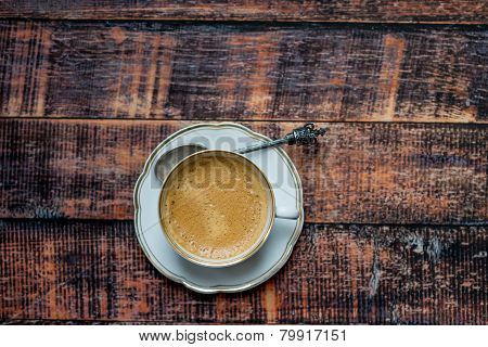 Vintage Cup Of Coffee On Old Wooden Table