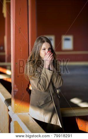 Woman In Beige Coat Warming Her Breath