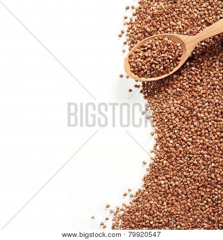 Buckwheat groats and wooden spoon