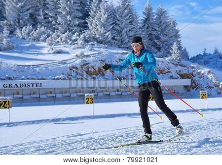 Young girl training at Cheile Gradistei Biathlon Arena - Cross country skiing