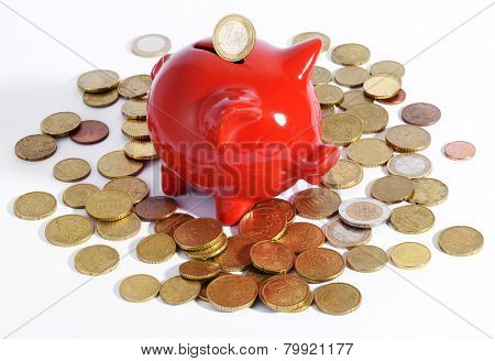 Red Piggy Bank Surrounded By Coins