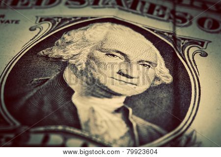 One dollar bill close up. Selective focus on George Washington eyes. USD, American Dollar. The United States currency, money concept