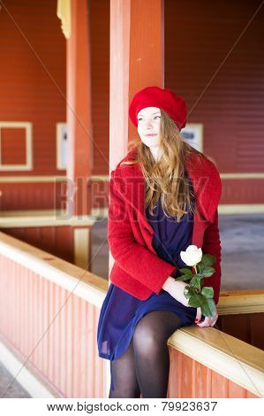 Woman On Station Boundaries Waiting Upcoming Train