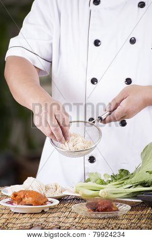 Chef Holding The Noodle To Colander Before Cooking