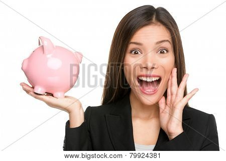 Woman holding piggy bank screaming and shouting excited and funny. Savings and banking with happy businesswoman holding pink piggy bank. Investment and savings concept.
