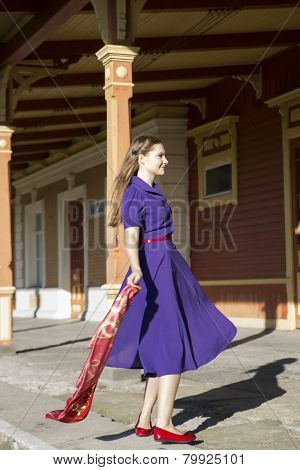 Woman In Lilac Dress And Red Shoes