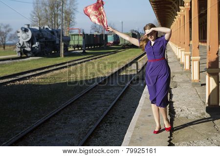 Woman In Lilac Dress At Windy Day