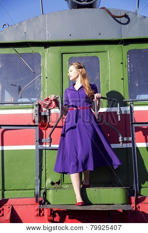 Woman In Lilac Dress At Train Back