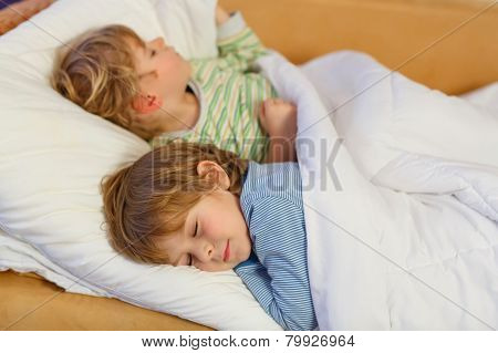 Two Little Blond Sibling Boys Sleeping In Bed