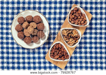 Varieties of nuts: almonds, hazelnuts and walnuts and chocolate balls