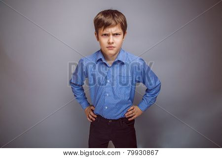 portrait a teenage boy frowning brown hair of European appear