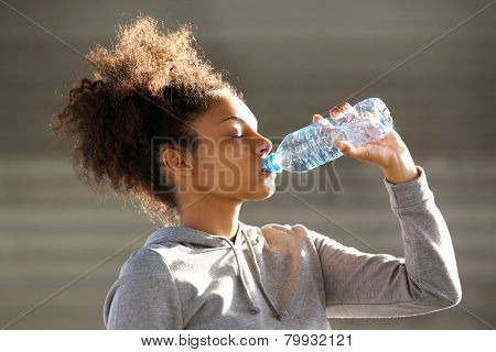 Attractive Young Woman Drinking Water From Bottle