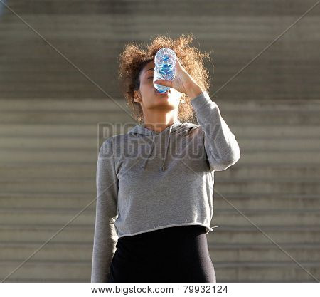 Thirsty Young Woman Drinking From Water Bottle