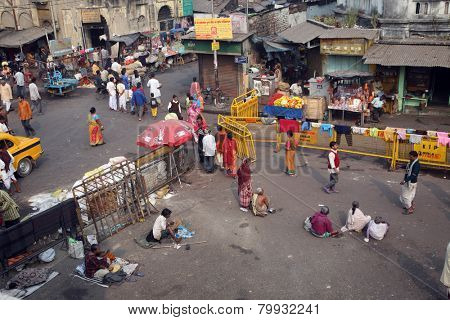KOLKATA, INDIA - JANUARY 24, 2009: Beggars in front of Nirmal, Hriday, Home for the Sick and Dying Destitutes, established by the Mother Teresa and run by the Missionaries of Charity in Kolkata, India