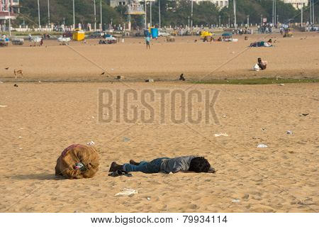 Chennai, India - February 10: An Unidentified Young Man Sleeps On The Sand Near The Marina Beach On
