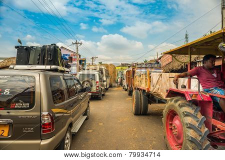 Thanjavour, India - February 13: An Unidentified Indian Man Standing In The Middle Traffic Congestio