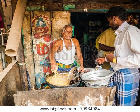Thanjavour, India - February 13: An Unidentified Indian Man Fries In Oil Of National Indian Food In
