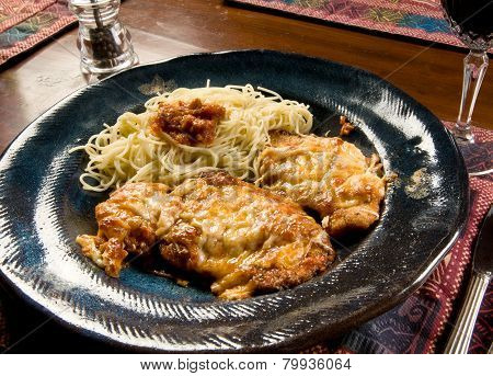 Chicken parmesan (or parmigana) with angel hair pasta