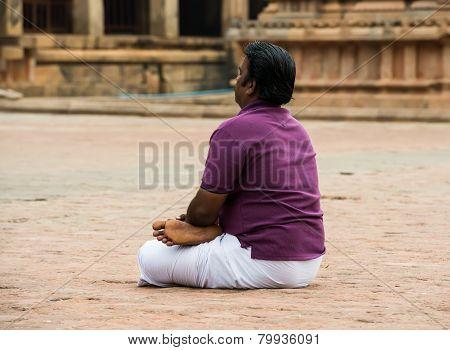 Thanjavour, India - February 14: An Unidentified Indian Man Sits In Brihadeeswarar Hindu Temple. Ind
