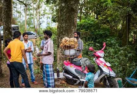 Munnar, India - February 18, 2013: An Unidentified People Are Gathered Near The Wild Honey. India, K