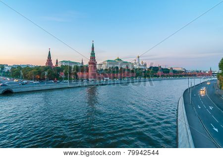 Red walls of the Kremlin and view on Moscow river