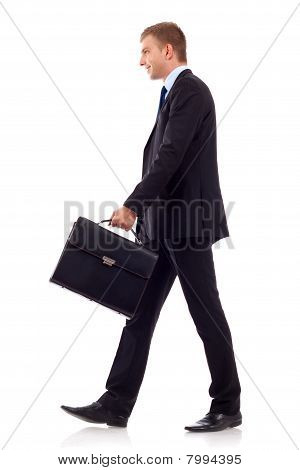 Walking Man Holding Brief