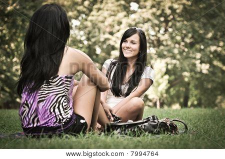 Two Friends - Girls Talking Outside In Park