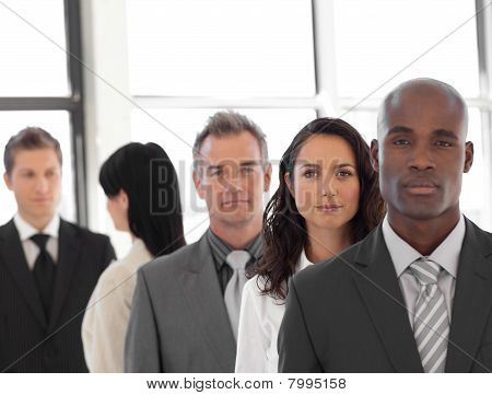 Serious Business Leader In Front Of Business Team