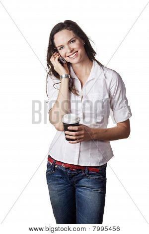 Portrait Of A Casual Beautiful Woman Talking On The Phone And Holding A Take Away Coffee