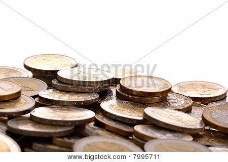 Heap of one and two euro coins isolated on white background