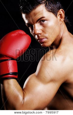 Muscular Man Fighting Box Over Dark