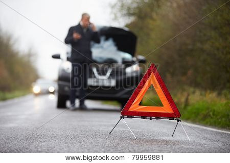 Motorist Broken Down On Country Road Phoning For Help
