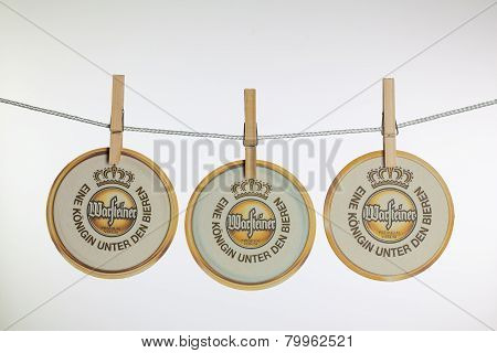 Beermats From Warsteiner Beer  Hanging From A Clothesline.