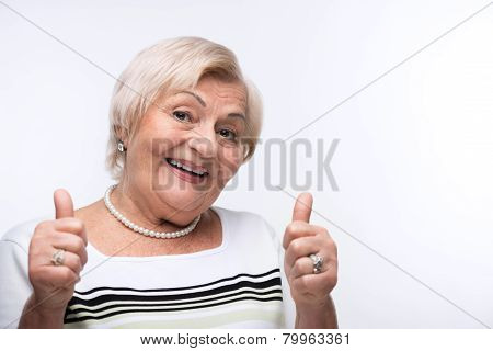 Elderly lady showing her thumbs up