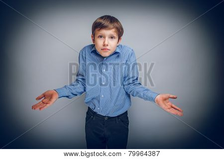 boy teenager of European appearance brown hair threw up his hand