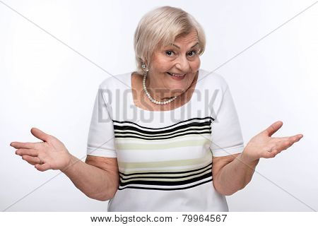 Closeup of elderly woman shrugging shoulders