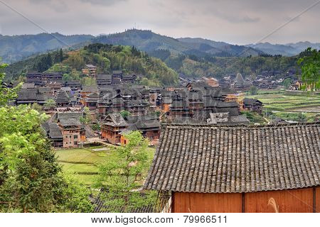 Wooden Houses Of Farmers In The Mountain Village Agricultural China.