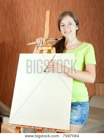 Woman Smiling While Painting A Picture